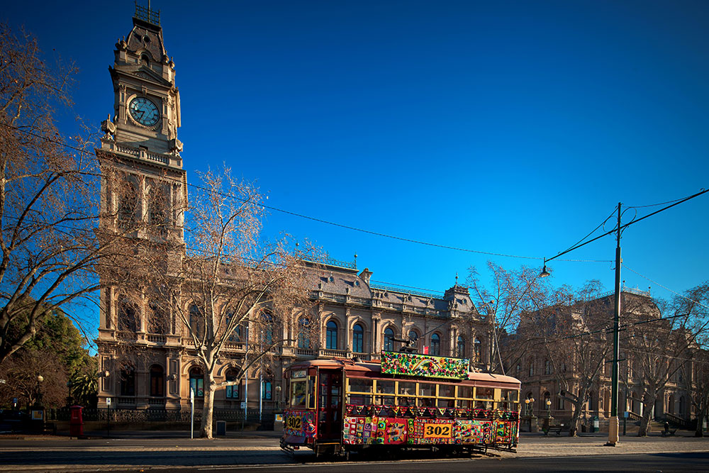 Yarn Bomb Tram passing the Visitor Information Centre on Pall Mall in Bendigo