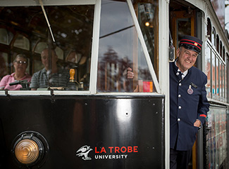 Tram driver standing in the doorway of a Bendigo Tramways Tram