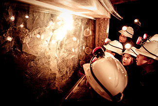 Students looking at gold on an underground Mine Experience Tour at Central Deborah Gold Mine
