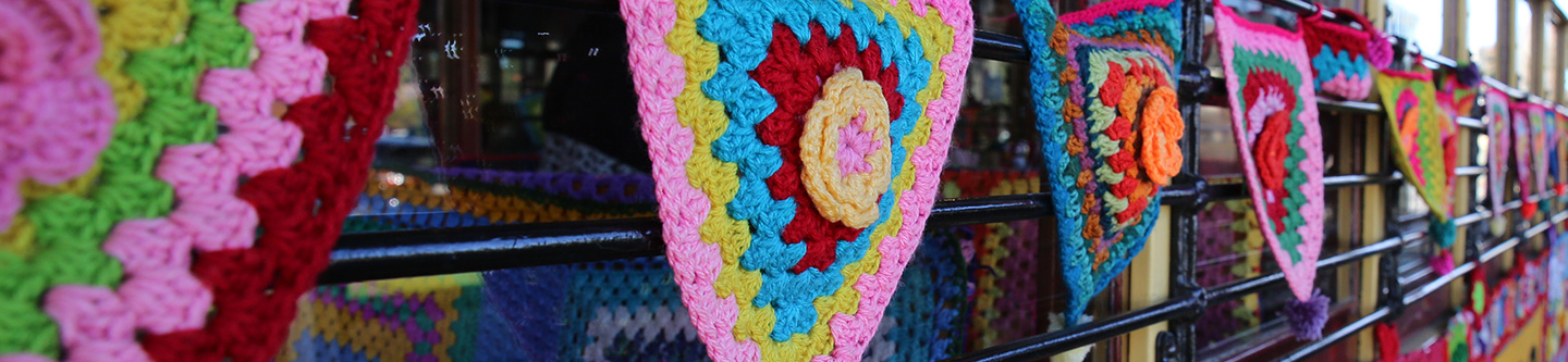 Close up of crochet bunting on the exterior of Bendigo