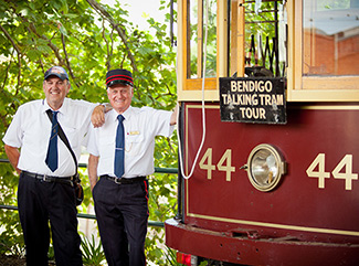 Two Tram Drivers standing with Vintage Talking Tram number 44 at the Bendigo Tramways Depot and Workshop