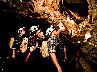 Visitors exploring the rock formations underground at Central Deborah Gold Mine