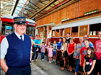 Tram Driver giving a group a tour of the Bendigo Tramways Depot and Workshop