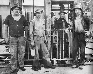 Central Deborah Gold Mine Miners standing at Cage