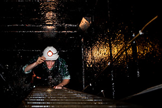 Climbing ladders on a Nine Levels of Darkness Tour at Central Deborah Gold Mine