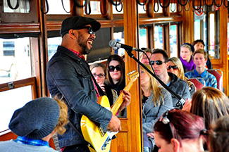 Musician performing aboard the Bendigo Tramways Blues Tram